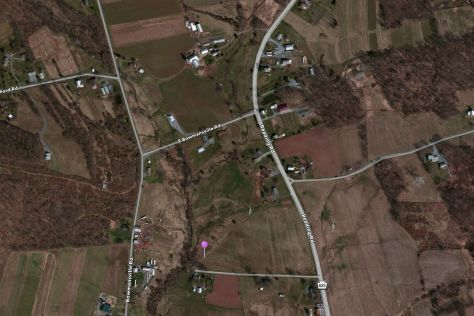 The current farm can be seen at the top and middle of this Google Map view. The purple pin still represents the spot of the possible cemetery.
